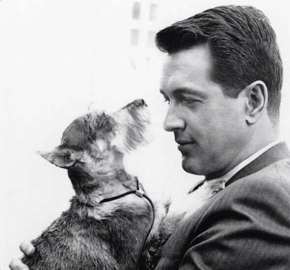 Rock Hudson with a funny little dog