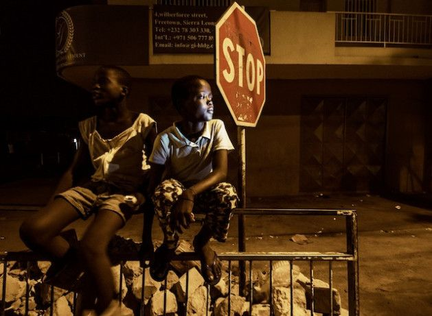 """Sierra Leone's Child Trafficking to Blame for Street Kids   News of the World """" free town """" Jun-- 7-- 2013 ( I p s) """" on a street corner in downtown Freetown Sierra Leone's capital city, 12-- year-- old Kita sits with a friend on a peeling steel railing watching the headlights of motorbikes cruising through the otherwise silent streets."""