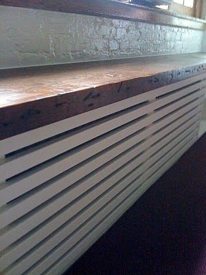 radiator cover with reclaimed wood along the top?