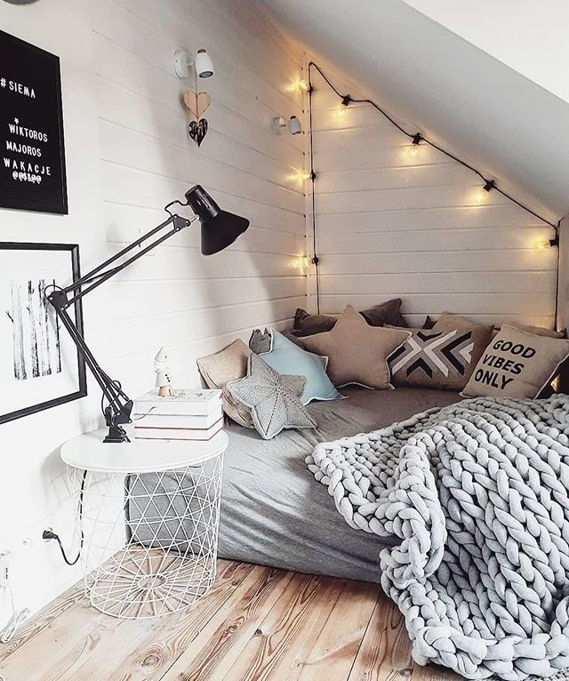 Cozy corner bed with soft lighting.