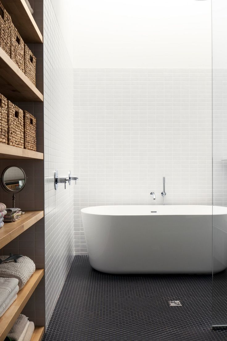 i like the mix of white and black tiles with the blonde wood, very ...