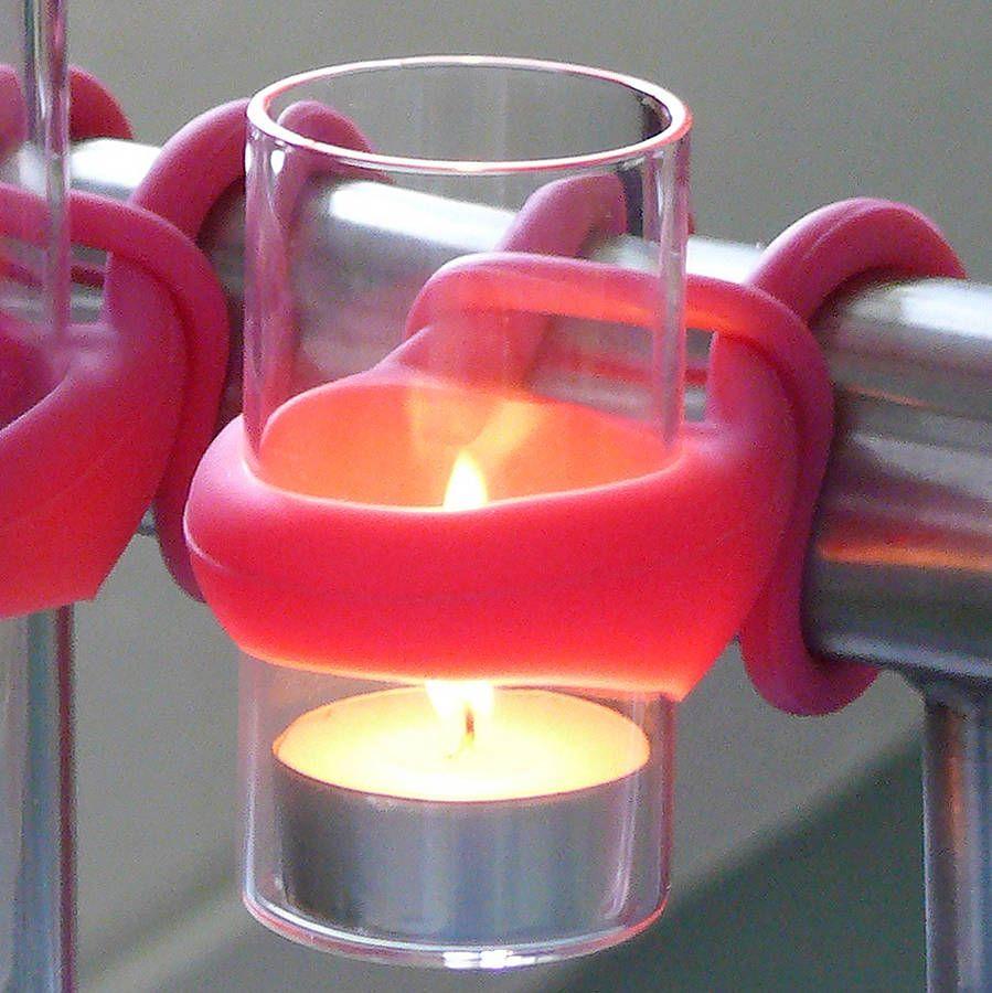 Pink holder to hang tea light candles on a balcony - Decoist