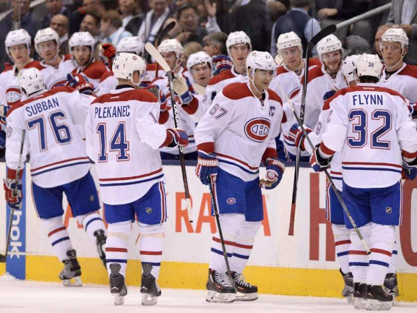 Montreal Canadiens players celebrate defeating the Toronto Maple Leafs in NHL action in Toronto on Wednesday, Oct. 7, 2015. The Canadiens defeated the Maple Leafs 3-1.