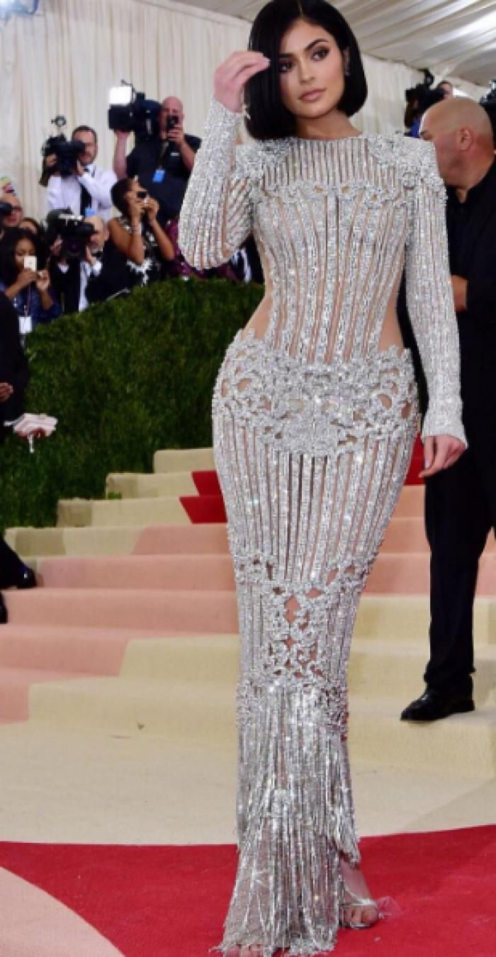 Kylie\'s gown had strategic bars of metal covering some of her more ...