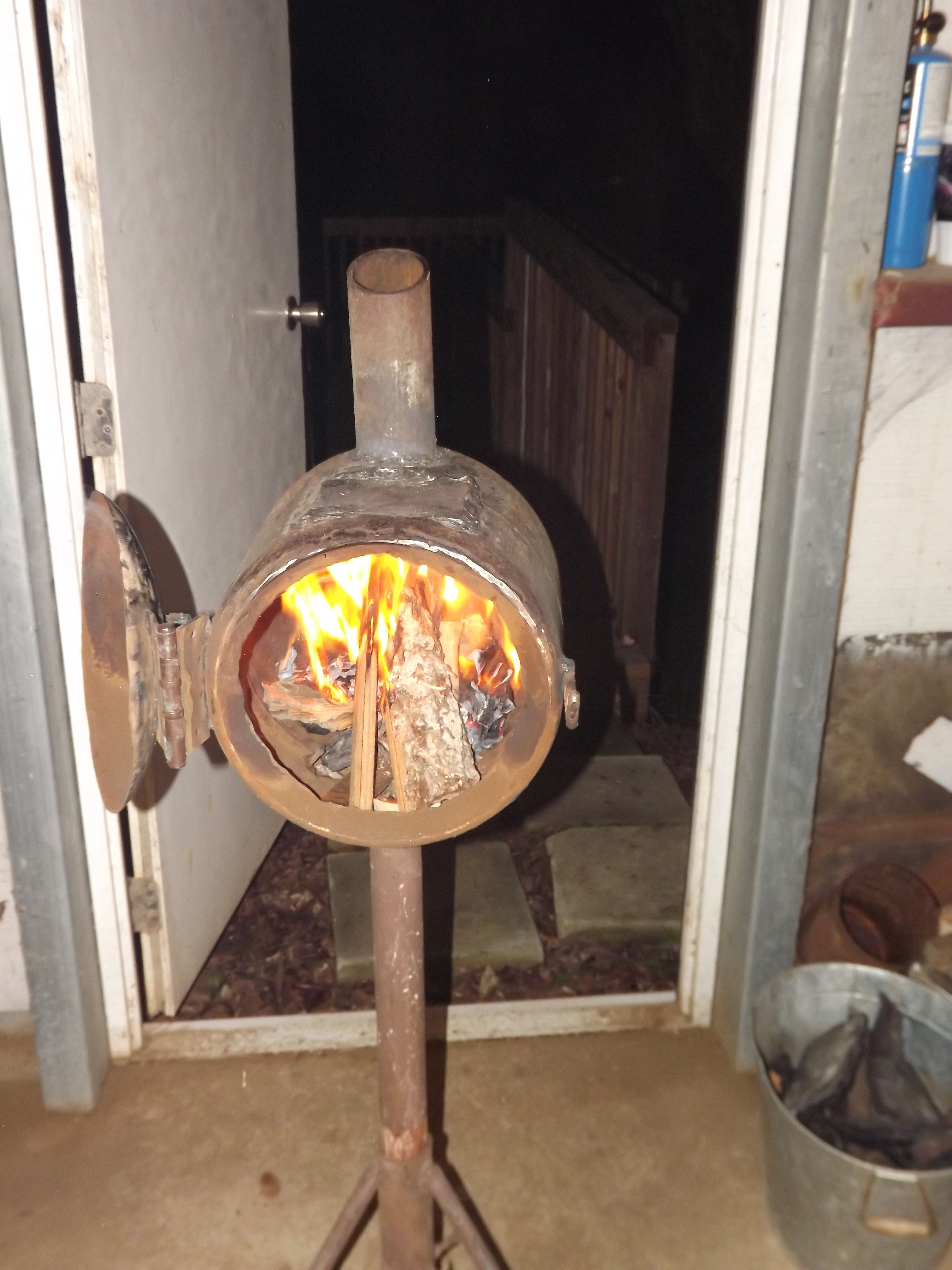 Simple Homemade Wood Stove From Old Propane Tank Campingstovehomemade Wood Stove Outdoor Wood