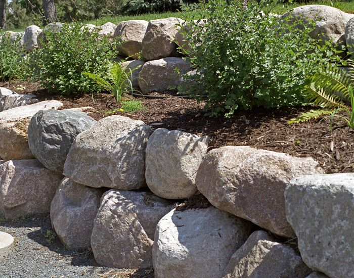 At Boulder Images We Design Boulder Retaining Walls That Fit Into The Natural Landscape Of Yo Boulder Retaining Wall Rock Wall Landscape Landscaping With Rocks