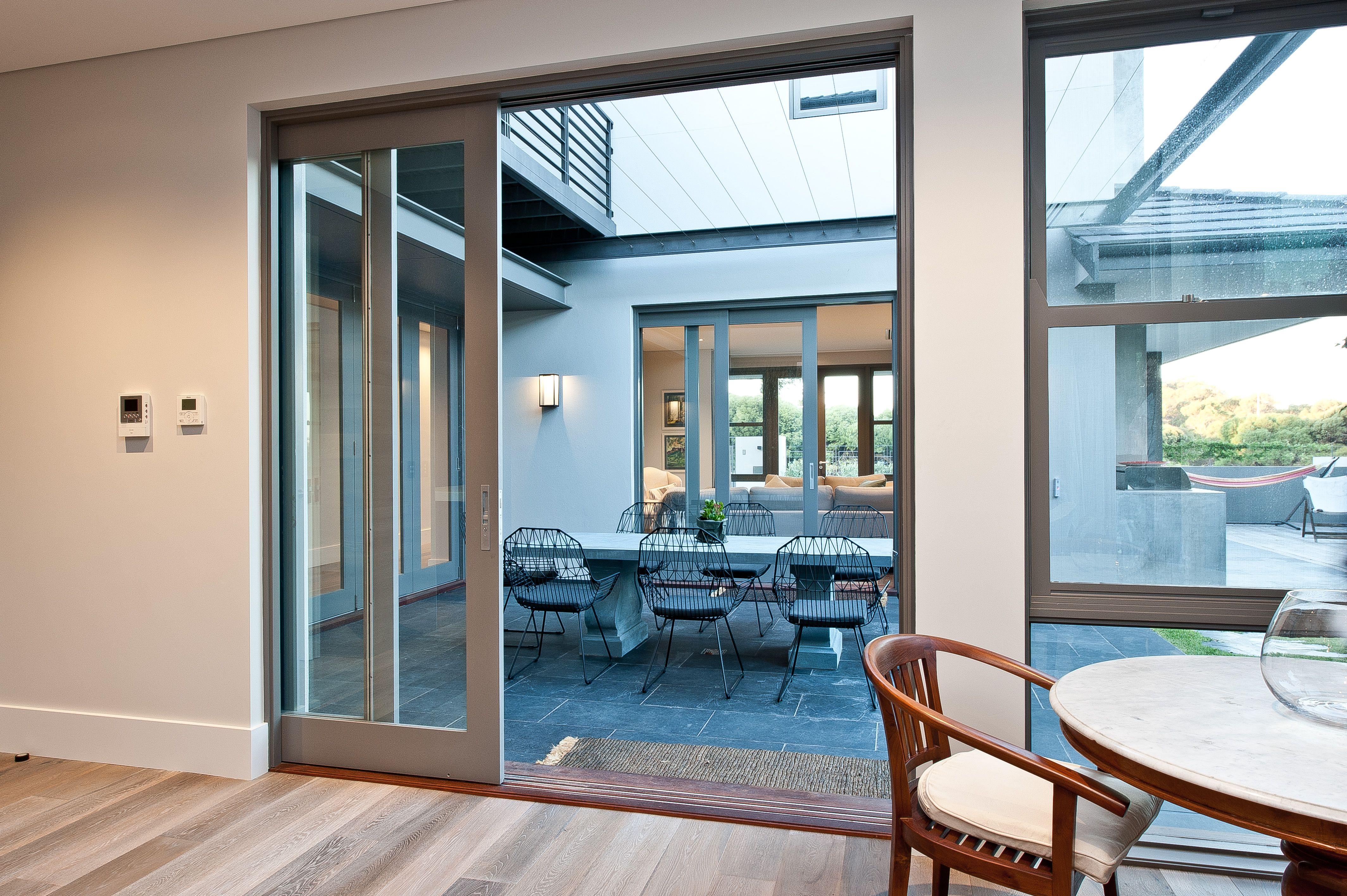 Partially Open Timber Cavity Sliding Door By Cedar West Sliding Glass Door Cavity Sliding Doors Glass Door