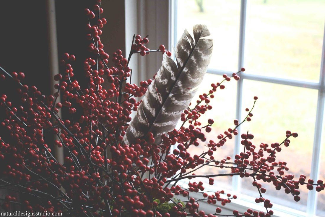 Winterberry and wild feather create a relaxed holiday centerpiece.