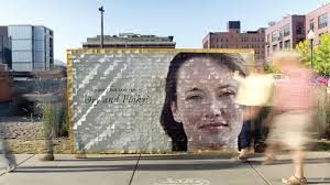 """To promote its Intense Hydration line, Burt's Bees placed a clever """"interactive"""" billboard on a busy street in Minneapolis. The sign showed a woman whose dry skin was made up of thousands of product coupons. These """"flakes"""" were peeled away by passersby over the course of a day, revealing an image of the same model with a creamier complexion"""