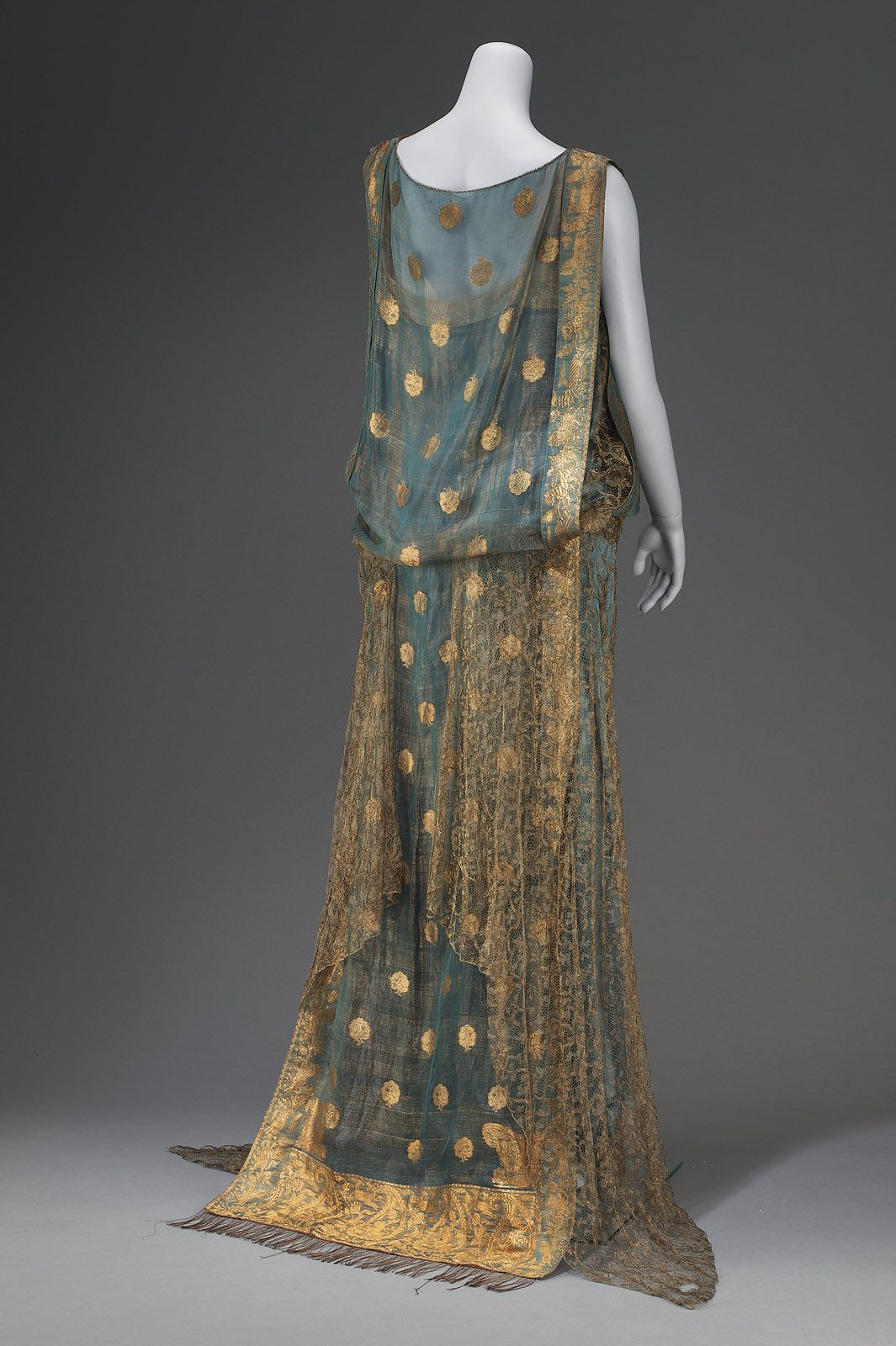 """VanderBiltmore Style"" Ladies Evening Dress CA. First Half Of 20TH Century MEDIUM OR TECHNIQUE: Silk brocaded with gold metallic yarns, silk satin, silk tulle, and metal snaps."