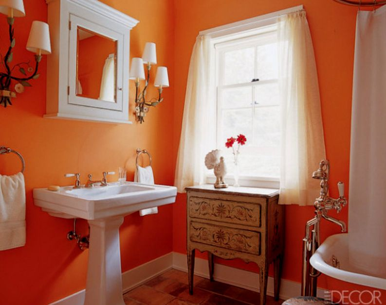 Tangerine Paint Color vintage style bathroom with tangerine orange walls | bathroom