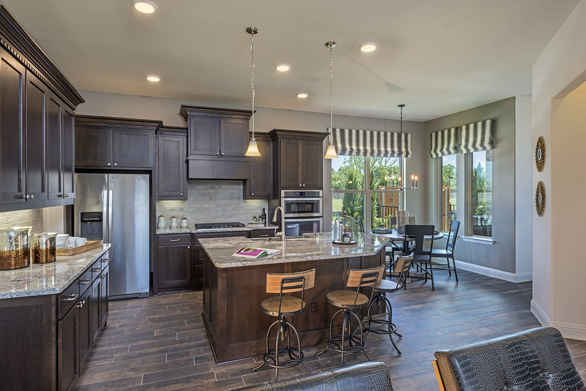 A Professionally Designed Kitchen With A Large Island And An