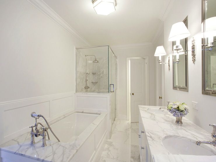 mastre bathroom with pale gray walls paint color seamless glass shower with marble tiles shower
