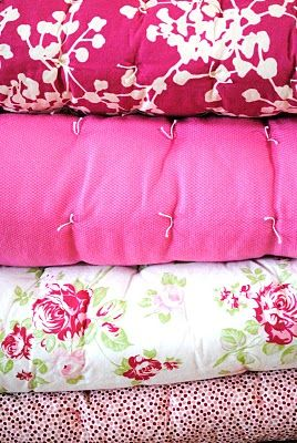 A stack of pink quilts....