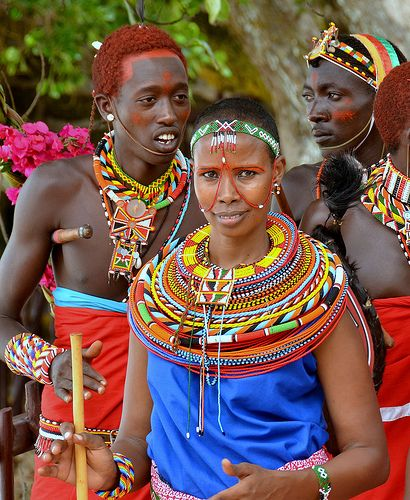 Colourful Maasai Girl In Traditional Dress And Beads At