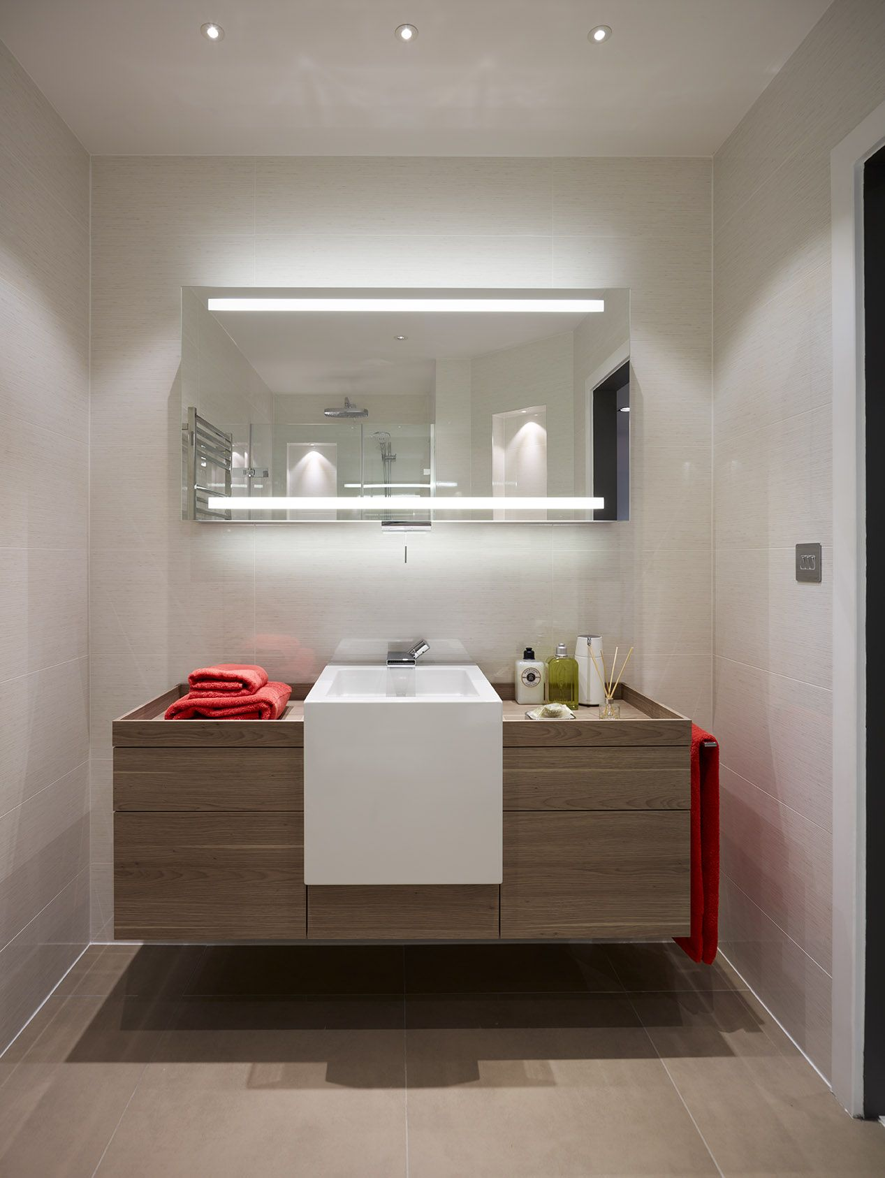 Inspirational An Alape wall hung wash area in wood effect laminate seemingly floats above Villeroy u Boch
