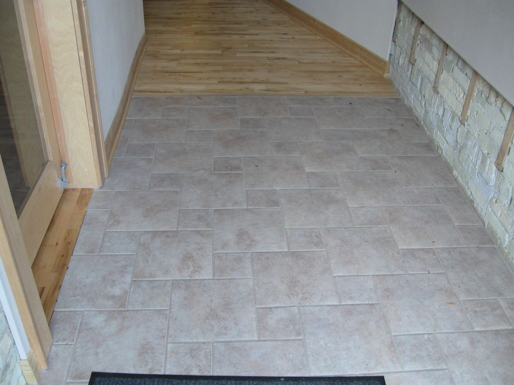 Floors combination tile and wood main entryway showing a tile to floors combination tile and wood main entryway showing a tile to hardwood transition dailygadgetfo Choice Image