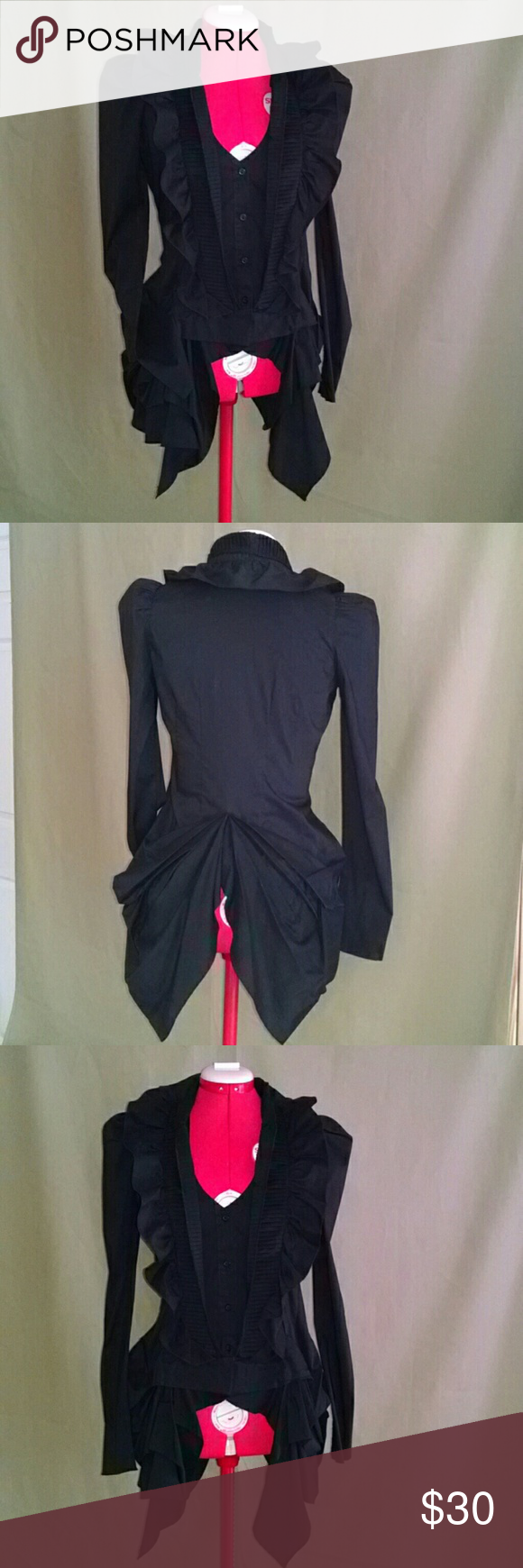 Super unique black top. This really cute unusual long sleeved top is an 80% cotton blend, slightly stretchy. Has vest style button up, with pleated ruffle and then another wavy ruffle, sides are bustle-y gathered and split in the back.  Worn once. It's about a size 2/4. Double Zero Tops