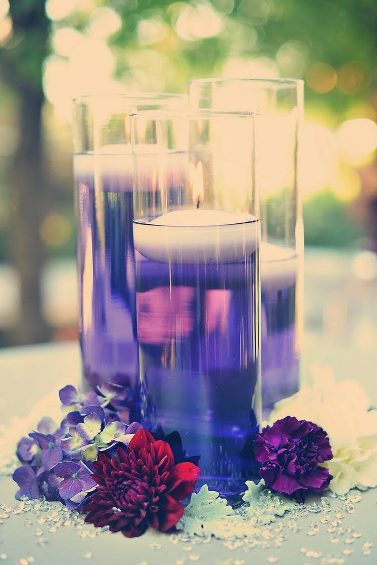 Floating candles colored purple food water and centerpieces use purple food coloring in the water with floating candles for a fun effect reviewsmspy