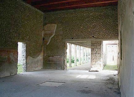 Main atrium at Estate of Julia Felix with doorway to portico and gardens at the center. Pompeii, Italy