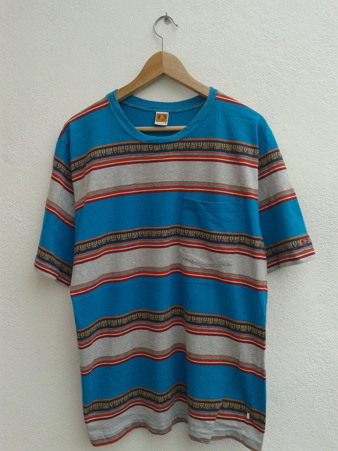 5aef0c21b SUMMER SALE Vintage 70s-80s Hang Ten Stripes Tribe Orange Tag Foot Print  Surfing Gear Pocket T-Shirt - $67.92 USD