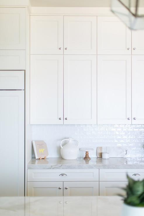 White Glazed Subway Tiles with Stacked White Shaker Cabinets - Transitional - Kitchen #whiteshakercabinets
