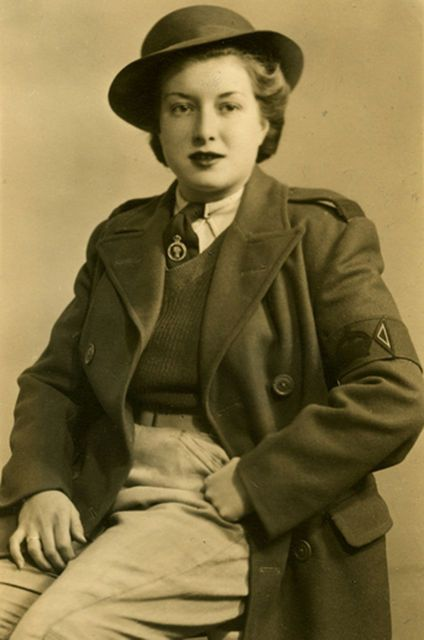Joan Fiske, in her Land Girl uniform, served from April 1942 to June 1945.
