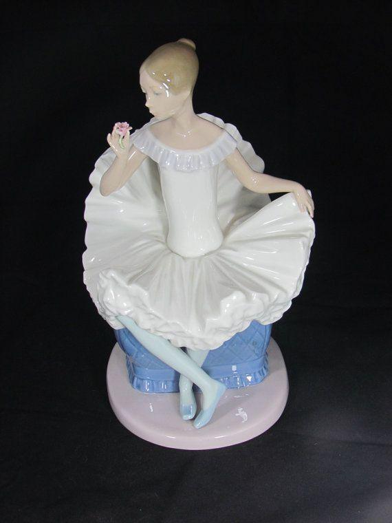Lladro Ballerina sitting in a blue chair - Lladro NAO 1983