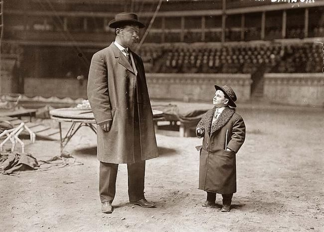 Photo shows Jack W.C. Barnett (right) who was a performer  with the Barnum and Bailey circus. The photo was taken  between ca. 1910 and ca. 1915.