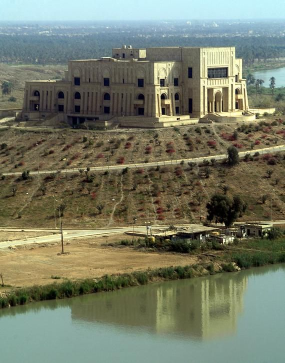 Saddam Hussein's former Babylonian palace on a hill above ...