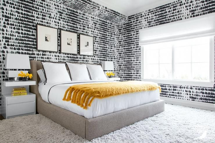 Stylish Black And White Bedroom Is Covered In Queen Of Spain Wallpaper And Features White Lacquered Nightstands Topped With Guest Bedroom Decor Home Home Decor