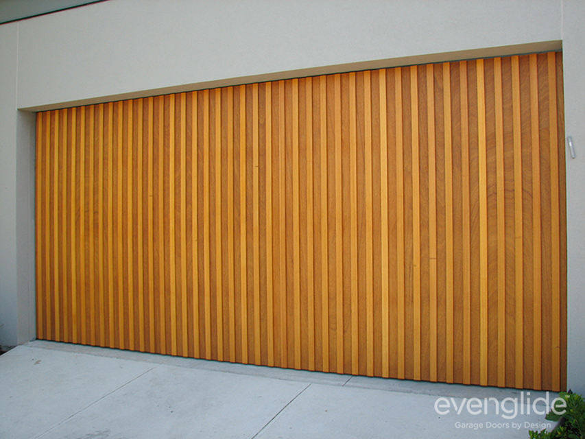 Timber Tilt Door Consisting Of Plywood Timber And Western Red Cedar Battens  Attached To The Face