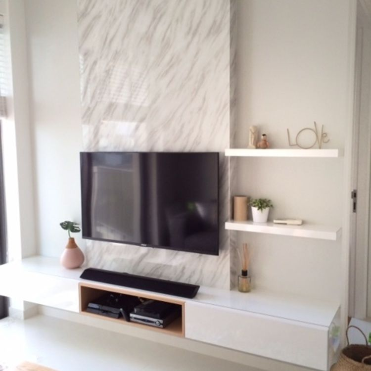 Tv feature wall with a single panel marble backdrop and ...