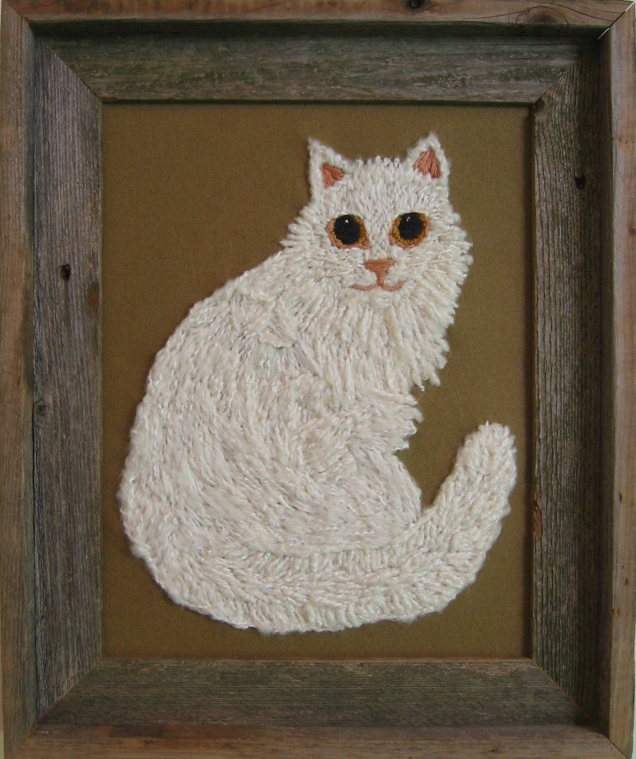 Mohair harn was used to make this bright eyed kitty. sold.