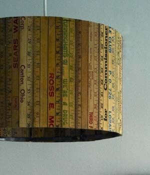 A lampshade covered in vintage rulers...for future nursery?  Kitchen?