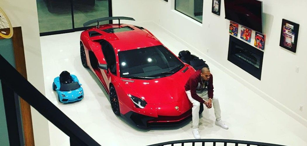 Just me and my car chris brown shared a photo of himself sitting on the hood of his brand new lamborghini aventador sv with the caption lamborghini in my