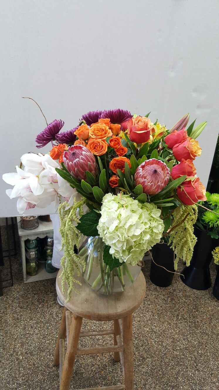Pink Flower And Orange Flower Arrangements For Wedding And Events