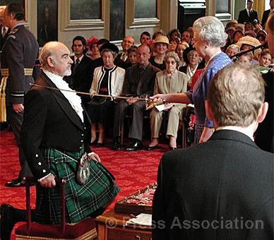 Sean Connery is knighted by The Queen at an Investiture ceremony at the Palace of Holyroodhouse, July 2000.