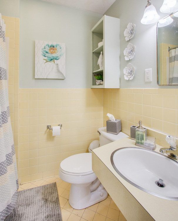 working with yellow vintage tile in bathroom makeover walls in  Sherwin-Williams Frostwork
