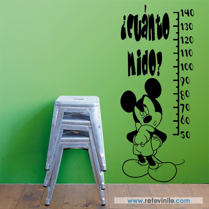 """Vinilos decorativo Infantiles Medidores - """" ¿Cuánto mide Mickey? """" para los niños que son fan de Mickey Mouse este diseño será el ideal para ellos, porque tendrán a su mejor amigo en la pared y a la vez servirá para verlos crecer, se recomienda colocar este diseño a 10 cm del suelo para usar el metro correctamente.  Se entrega una pieza de 54x131 cm principal elegido. La parte de la sonrisa y los ojos será en color negro. Incluye espátula e instrucciones de colocación.   45 €"""