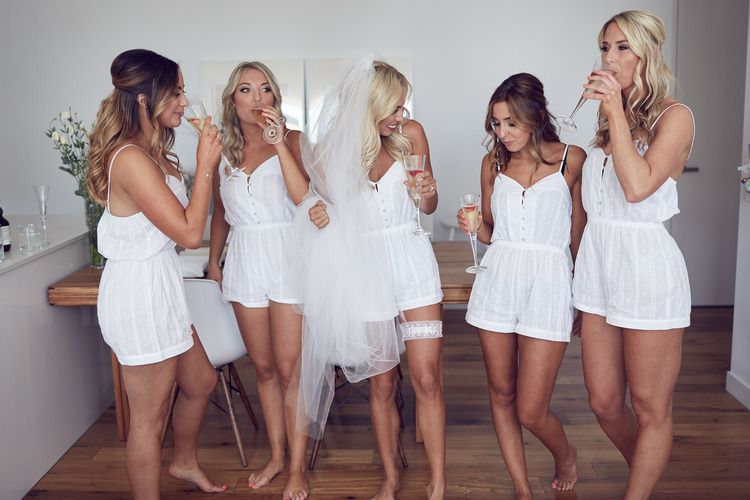 a2d3b90288b3 Cute white bridesmaid rompers to get ready in pre wedding