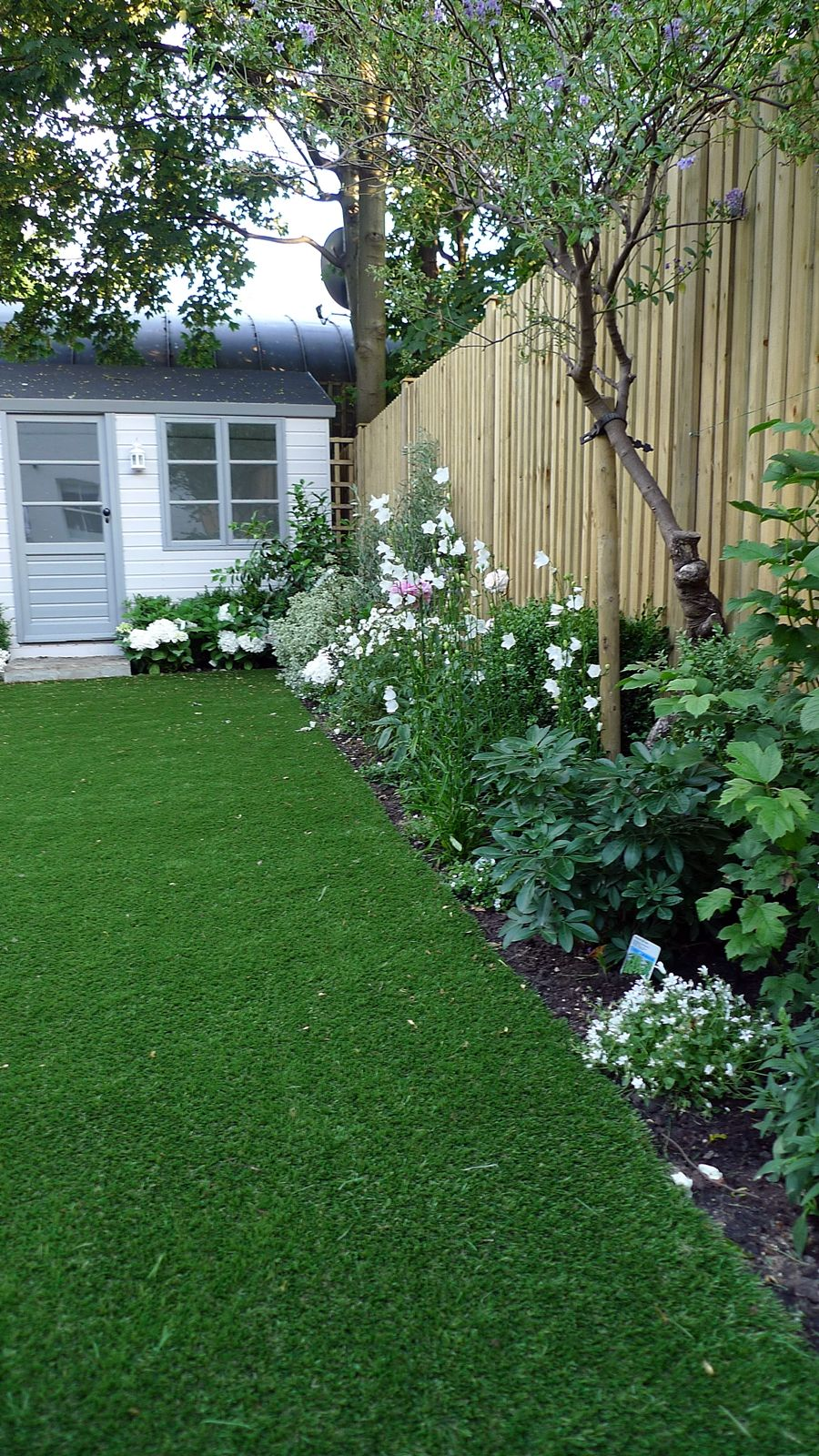 Artificial Easy Grass Lawn Summer House Sandstone Paving And White