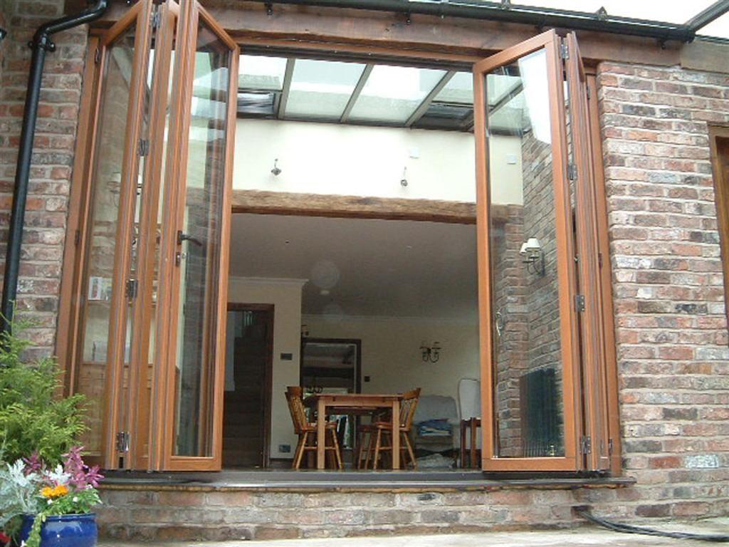 Tall folding sliding doors 154 house pinterest doors for Sliding glass doors garden