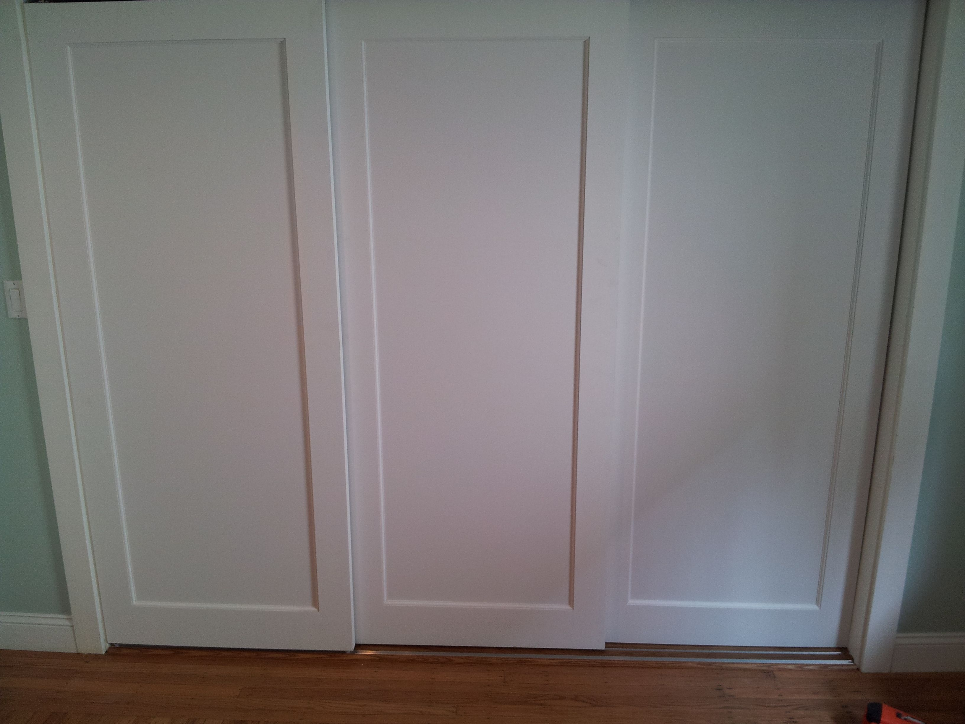 Installed 3 Panel Doors On Custom Sliding Track For Extra Wide Closet.