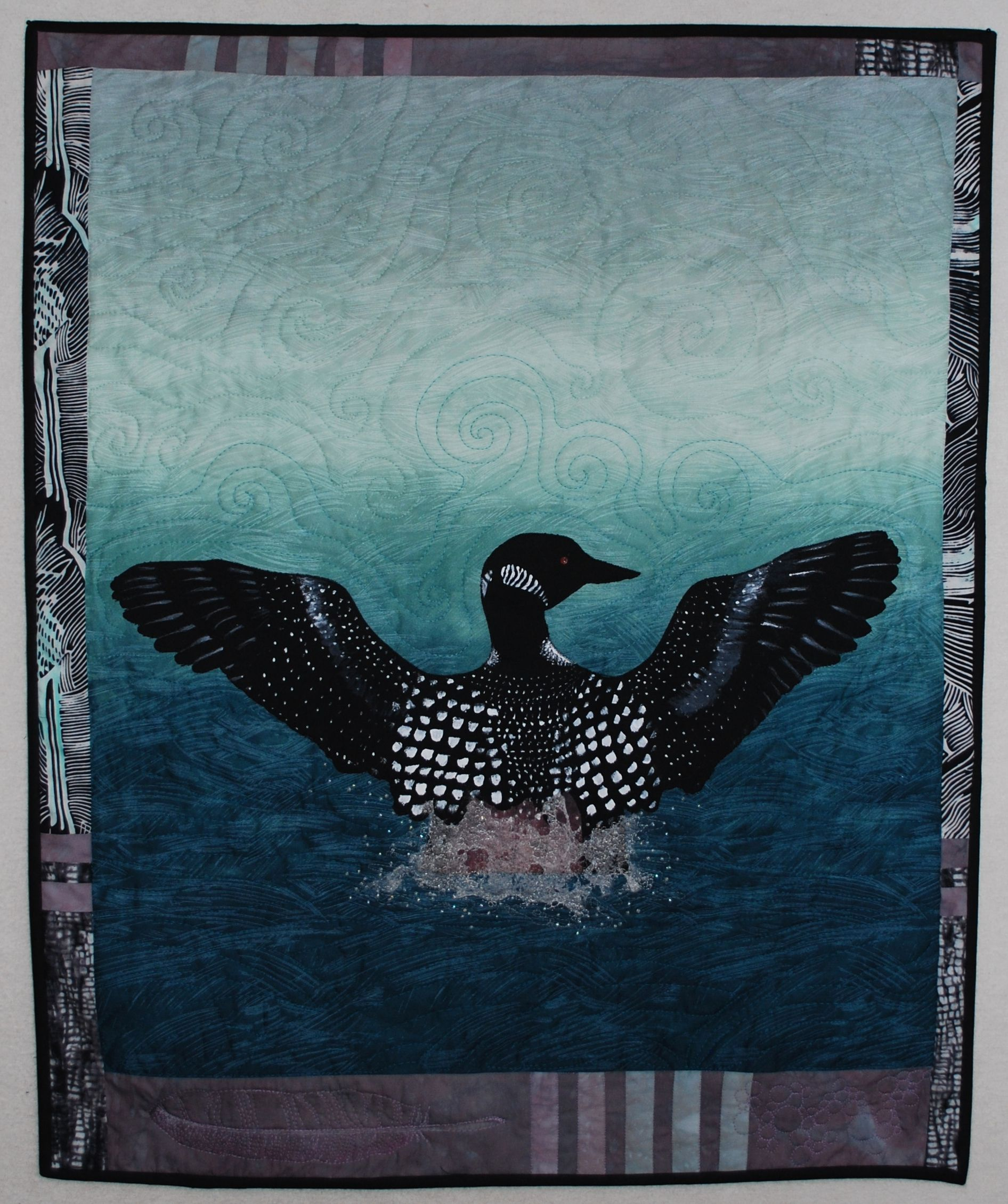Loon Ascending by Regina Marzlin. The bird is painted and ... : loon quilt pattern - Adamdwight.com