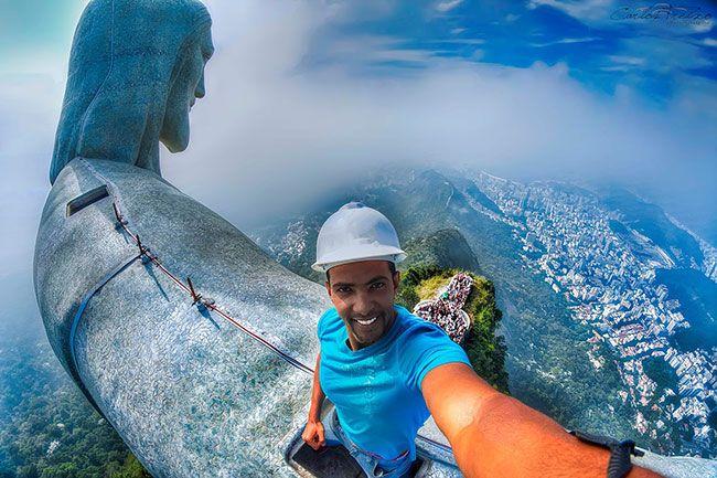 Worlds Most Impressive Selfie Taken On The Foot Metre - Guy takes epic selfie top christ redeemer statue brazil