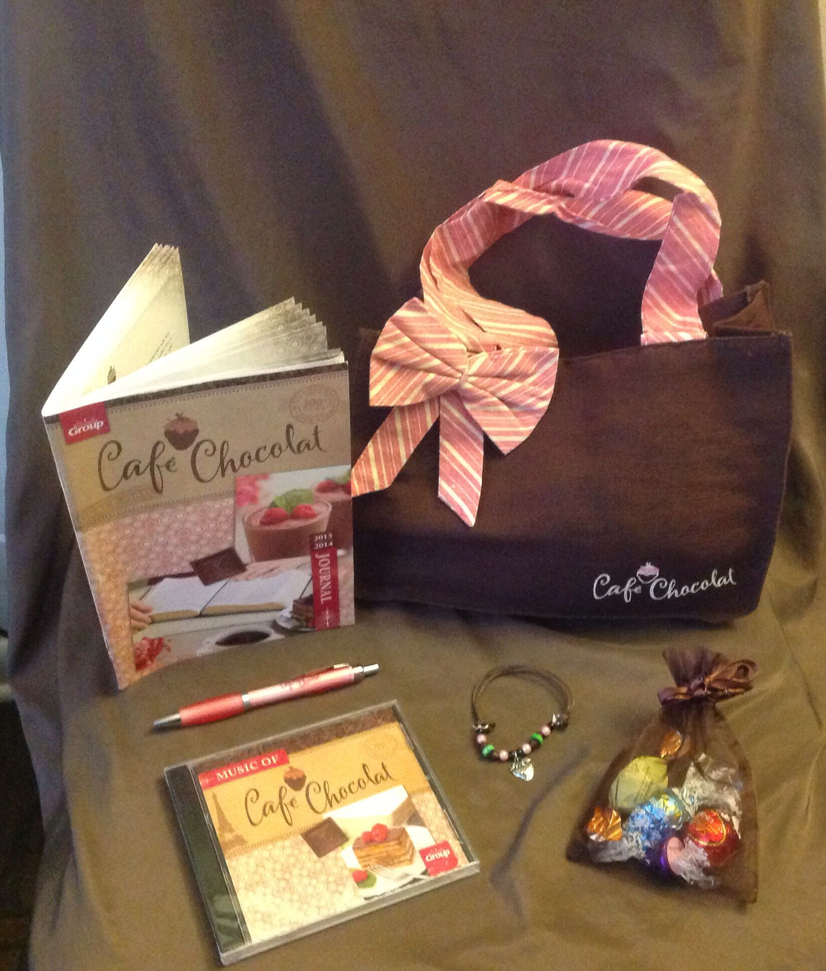 Tote bag, journal, pen, bracelet & CDs given to the ladies.