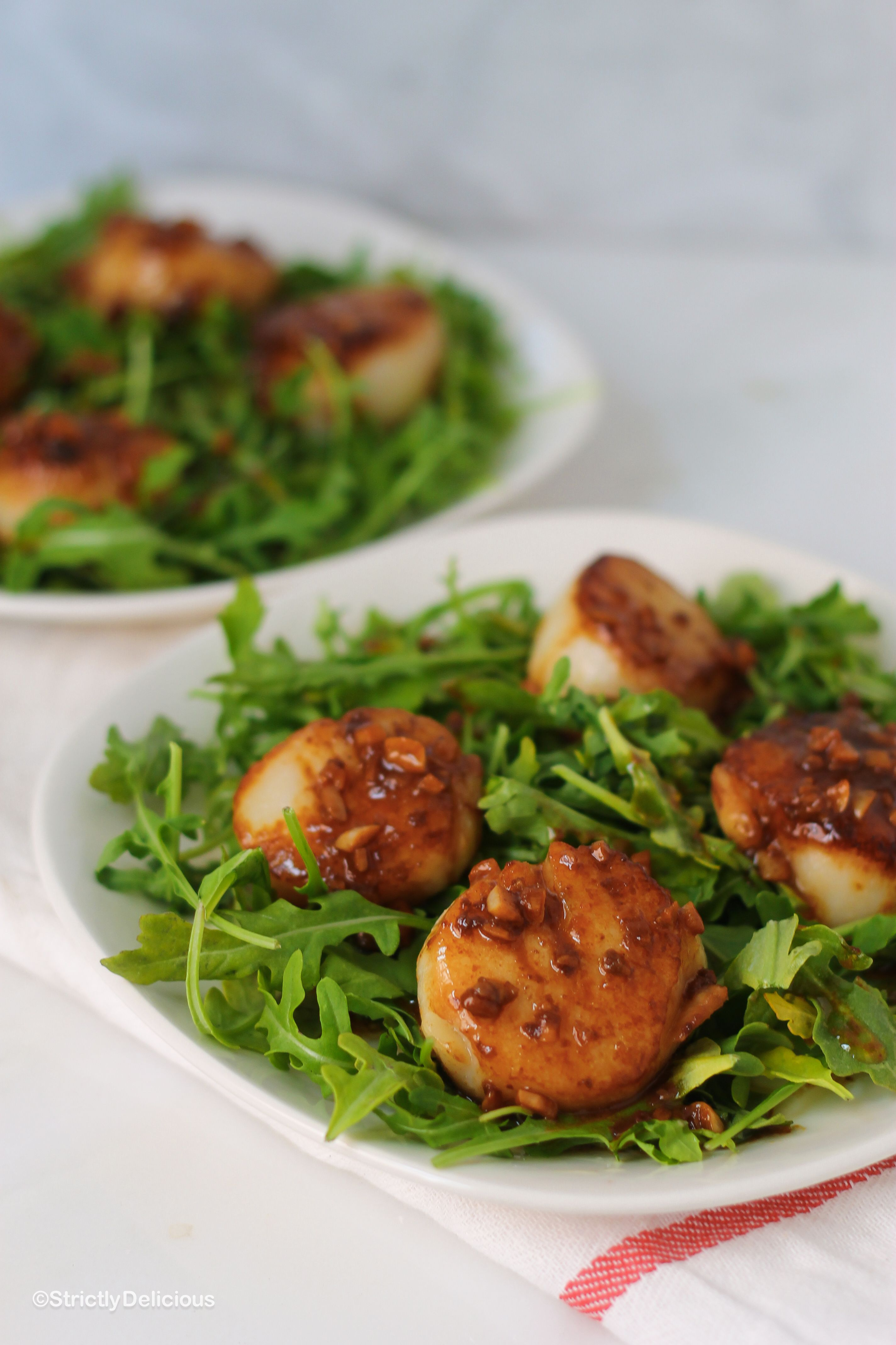 Seared Sea Scallops over Arugula with White Wine Garlic Sauce (sub garlic-infused oil for garlic) / Strictly Delicious