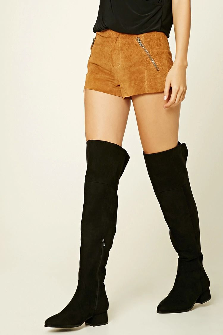 8eccdb52d53 A pair of faux leather knee-high boots featuring a side zipper ...
