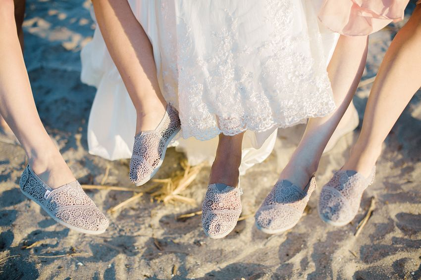 The girls slipped on ivory crochet TOMS post ceremony - lovely idea for beach weddings!  {Chad & Siu's Wild Dunes Wedding; Photo by STUDIO 1250}